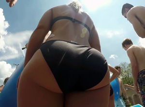 Giant backside in bathing suit at..