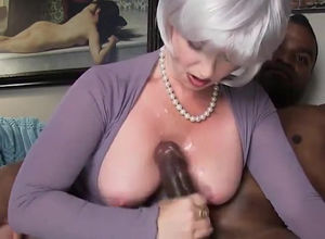 Meaty  mature damsel invites dark-hued..