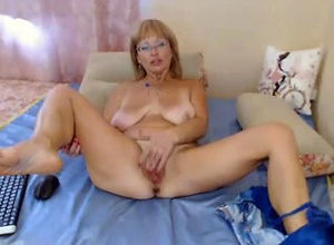 Mature doll romps herself by  on web cam
