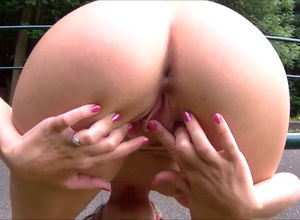 Pretty blondie doll pissing outside