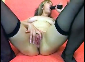 Phat dark-hued fake penis used for..